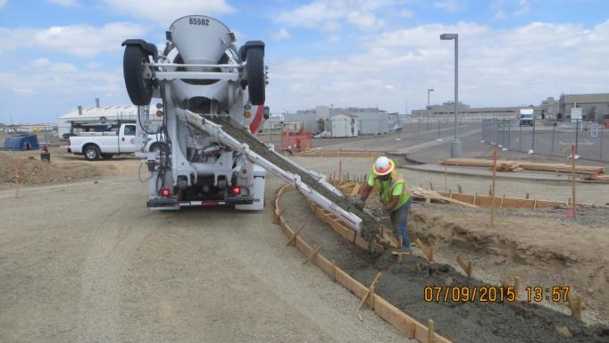 Placing concrete curb and gutter for roadways and intersection as part of Site Preparation work (July 2015)
